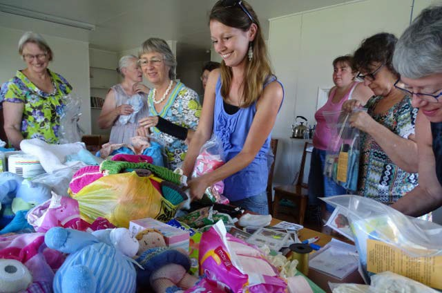 MAF women preparing care packs for new mums in PNG