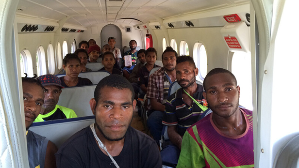 PNG students are transported to school by aircraft