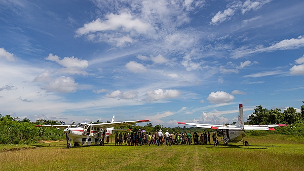 MAF aircraft at Derepos airstrip, Papua, Indonesia. Photo by Mark and Kelly Hewes.