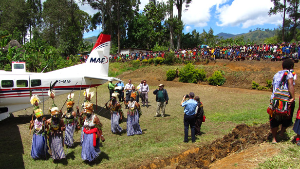 Kompiam locals greet the arrival of MAF at the hospital in full local dress.