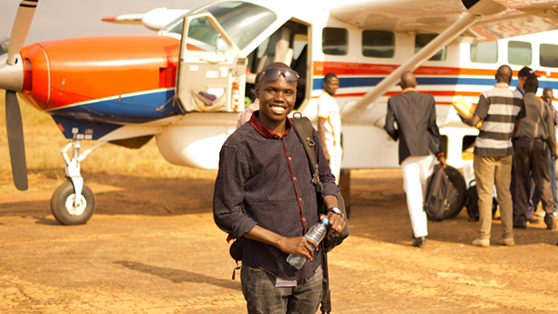 Donald Itti arrives together with five ACTED colleagues at the airstrip in Maridi, South Sudan, on MAF's Caravan.