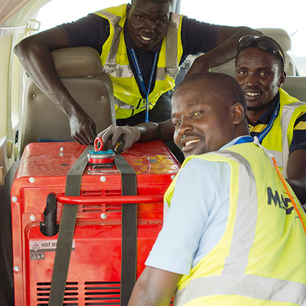 MAF South Sudan Dispatch Team and a generator for Tearfund