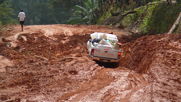 Roads in Liberia are unpaved, muddy and have huge potholes. Photo credit Mark Sheppard