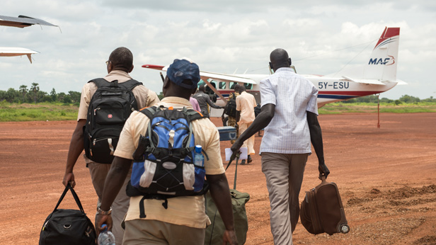 Pilot Ryan Unger arrives in Rumbek to pick up the CMA Eye Team for transport to Mundri.