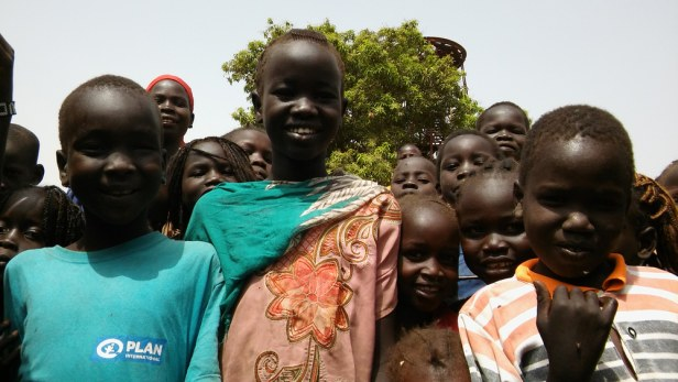 Happy children having been given water