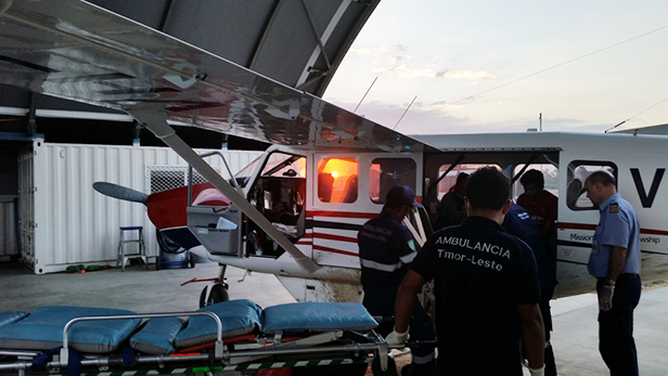 A late medevac flight arrives back in Dili and the patient is transferred to the ambulance. Photo credit Marcus Grey, Copyright Mission Aviation Fellowship.
