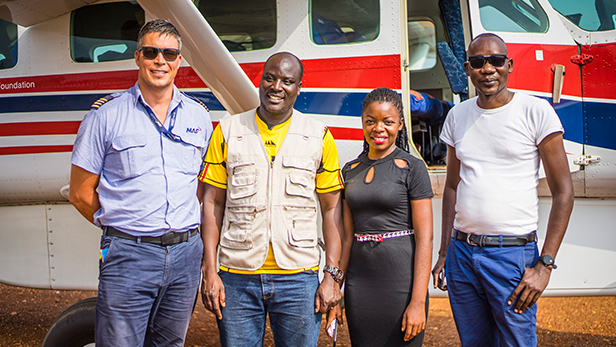 Pilot Matt Eagar with 3 members of Tutapona staff