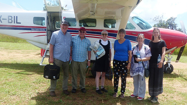 Teachers and Brickworks staff in front of the MAF plane